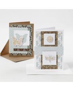 Tarjetas de felicitación decoradas con papel de diseño y diseños troquelados con lámina decorativa.