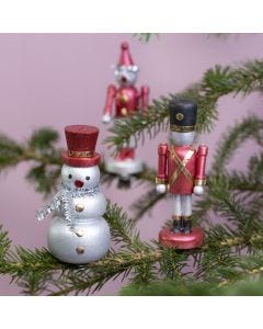 Wooden figures on pegs decorated with Art Metal paint and deco foil