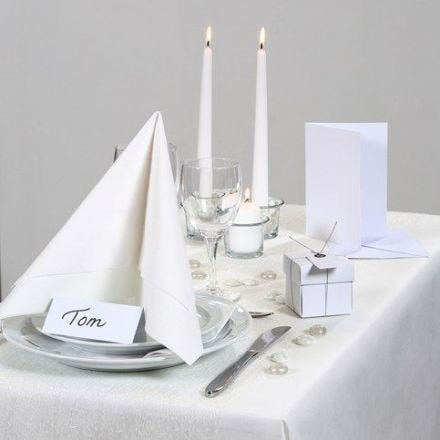 Party Inspiration with white Table Decorations etc.