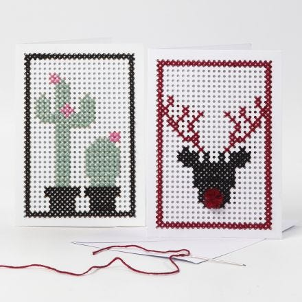 Tarjetas de felicitación bordadas con un cactus y un reno