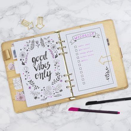 Una lista de deseos dibujada en un bullet journal.