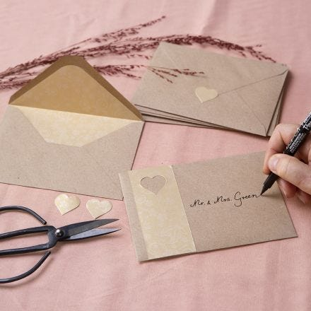 Envelopes from recycled paper decorated with gold paper