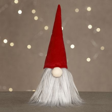 Un duende con una barba larga y un sombrero de duende de terciopelo