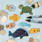 Sea creatures painted on stones with markers and decorated with bio glitter