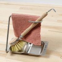 Un paño de cocina tejido a ganchillo usando puntos de ganchillo doble