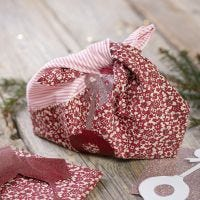 A recycled fabric bag with designs