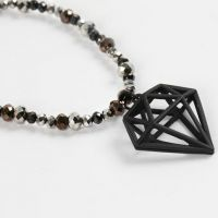 A Necklace with faceted Beads and a Diamond Pendant