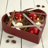 A Heart-Shaped Wooden Bowl with Decorations