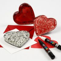 A transparent Glass Heart with a Card Decoration underneath