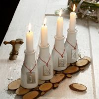 An Advent Candle Holder from Milk Bottles with numbered Zinc Tags