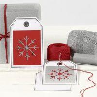 Tarjeta de regalo con copo de nieve bordado