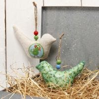 A Fabric Bird for hanging, decorated with Decoupage Paper & Beads