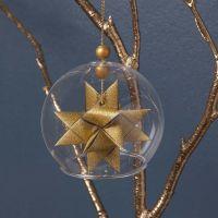 Campana de cristal con estrella dorada dentro