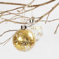 Una bola de cristal con estrellas doradas pequeñas en su interior