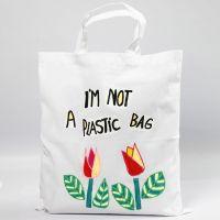 Una bolsa de compras decorada con diseños de papel de transferencia recortable