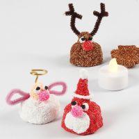 Figura navideña de Foam Clay sobre vela LED