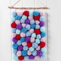 Un tapiz hecho de Pom-poms