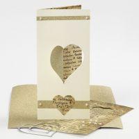 Una tarjeta triple con medio corazón perforado usando la máquina troqueladora y embossing