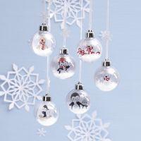 Bolas de Navidad con un dibujo de animales en el interior para decorar
