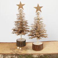 Árboles de Navidad hechos de formas de papel de imitación piel troqueladas