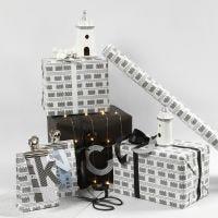 Envoltorio creativo con papel negro y blanco con faros y luces de faro