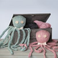 A knitted Octopus with a Satin Ribbon Bow Tie