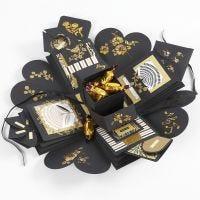 Una explosion box como regalo con dinero y chocolate.