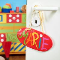 A hanging door sign made from Fimo modelling clay