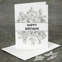 Una tarjeta de felicitación de cumpleaños decorada con pegatinas Washi.